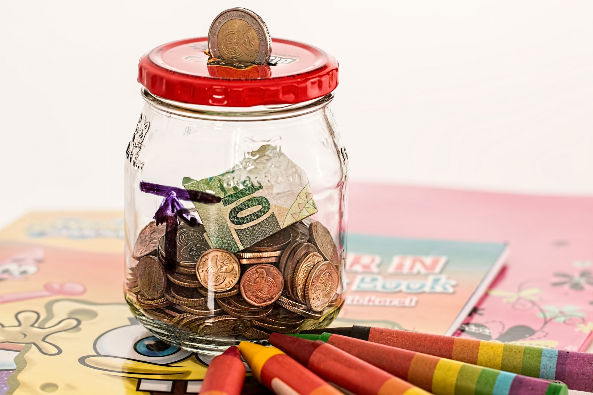 image of money saving jar - good financial habits