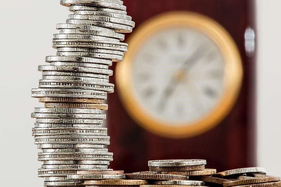 keep your finances in check - coins and clock image