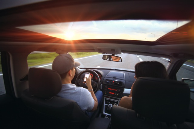 teaching teens the financial value of safer driving - drive and text image