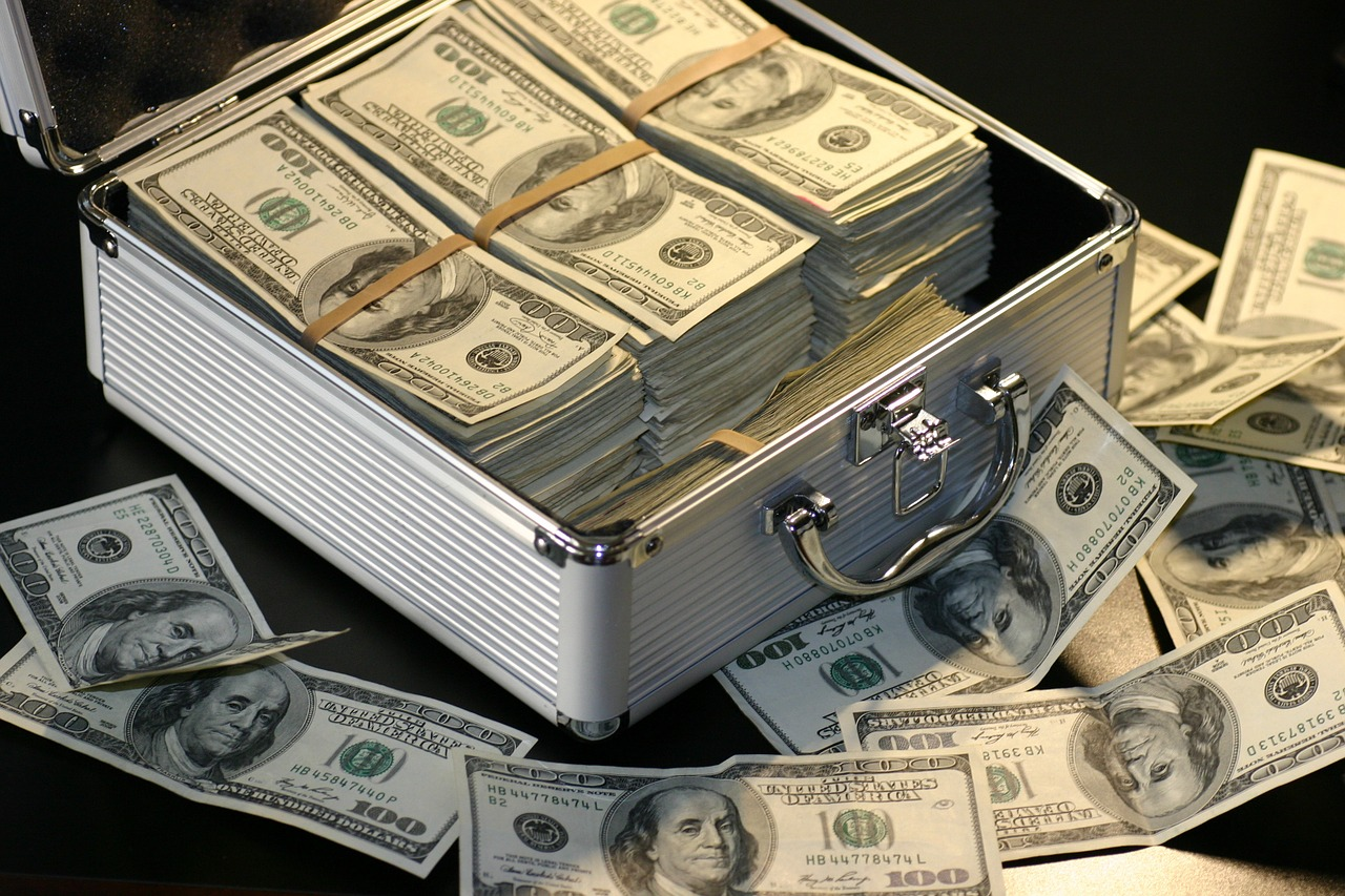 ways to dodge debt - suitcase of money image