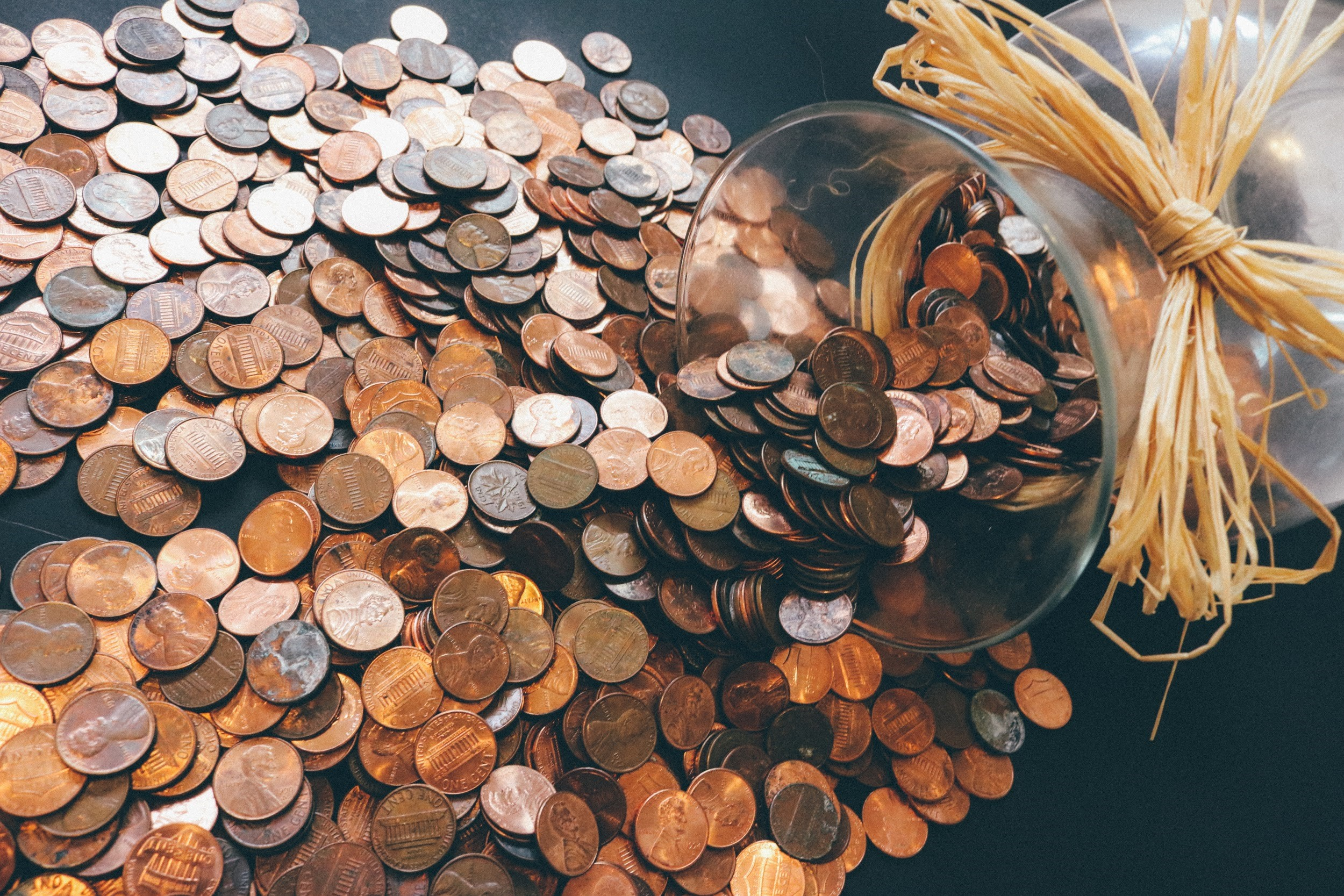 Save The Pennies Now For Your Children's Future - jar of pennies image