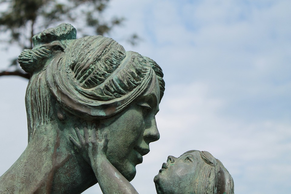 Prepare Your Money For The End - mother and child statue image