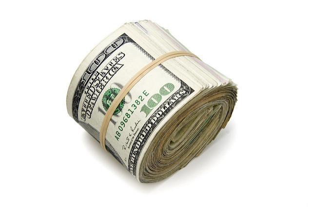 Strategies for raising emergency capital - roll of dollar bills image