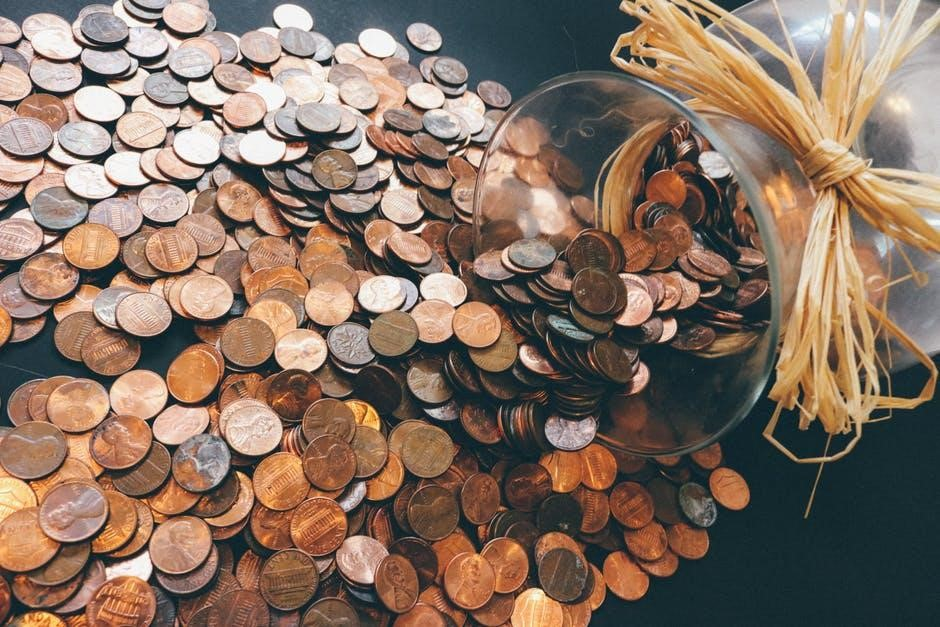 Mind Over Money: Taking Control of Your Finances - jar of coins image
