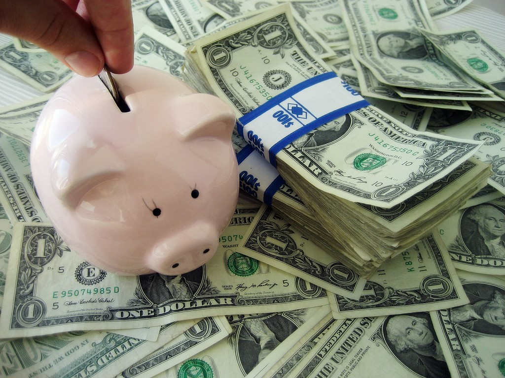 Achieve Regular Financial Savings By Incorporating These Simple Tricks Into Your Life - piggy bank image