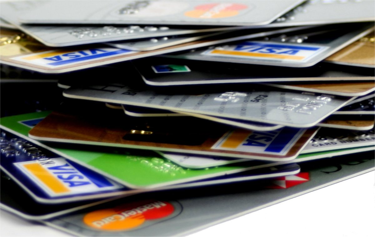 Money Math: Valuable Lessons To Learn At College - credit card pile image