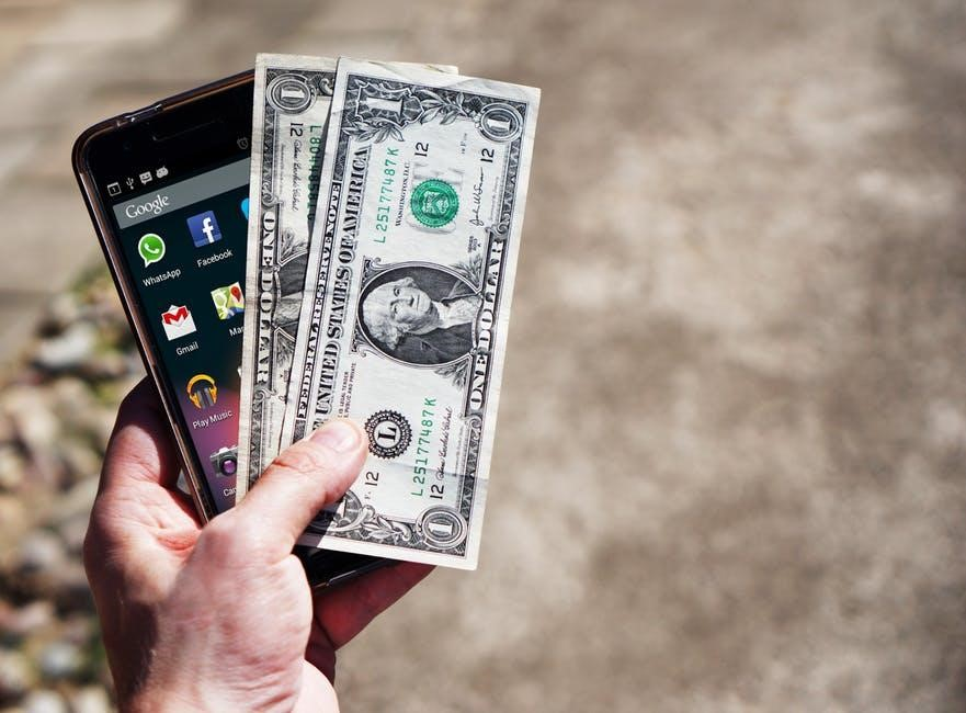 4 Ways The Internet Can Solve Your Cash Problems - dollars and phone image