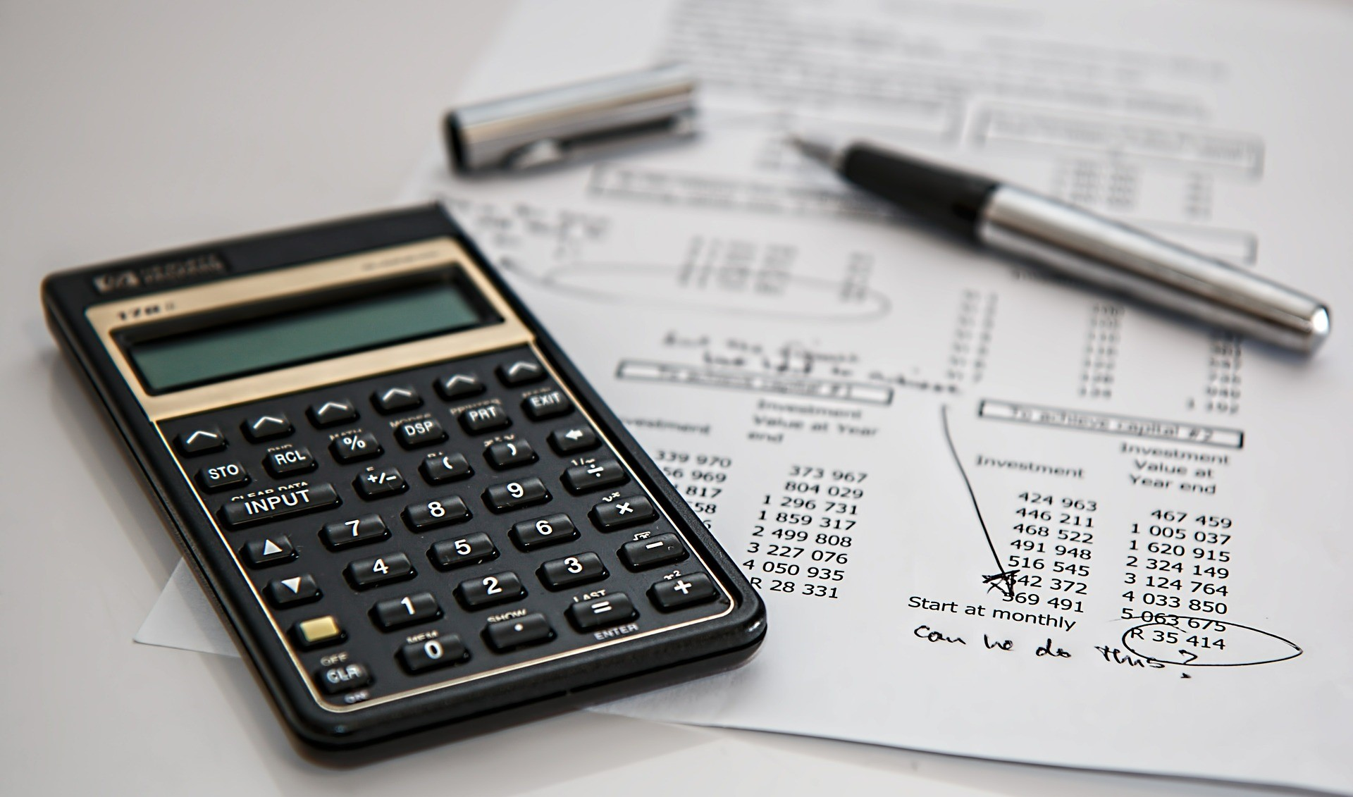 How to Keep on Top of Your Businesses Accounting - calculator and accounts image