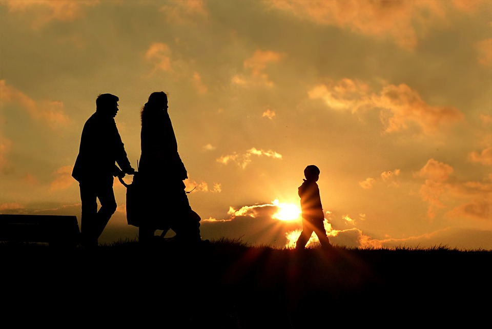 Teaching Your Children About Death - family at sunset image