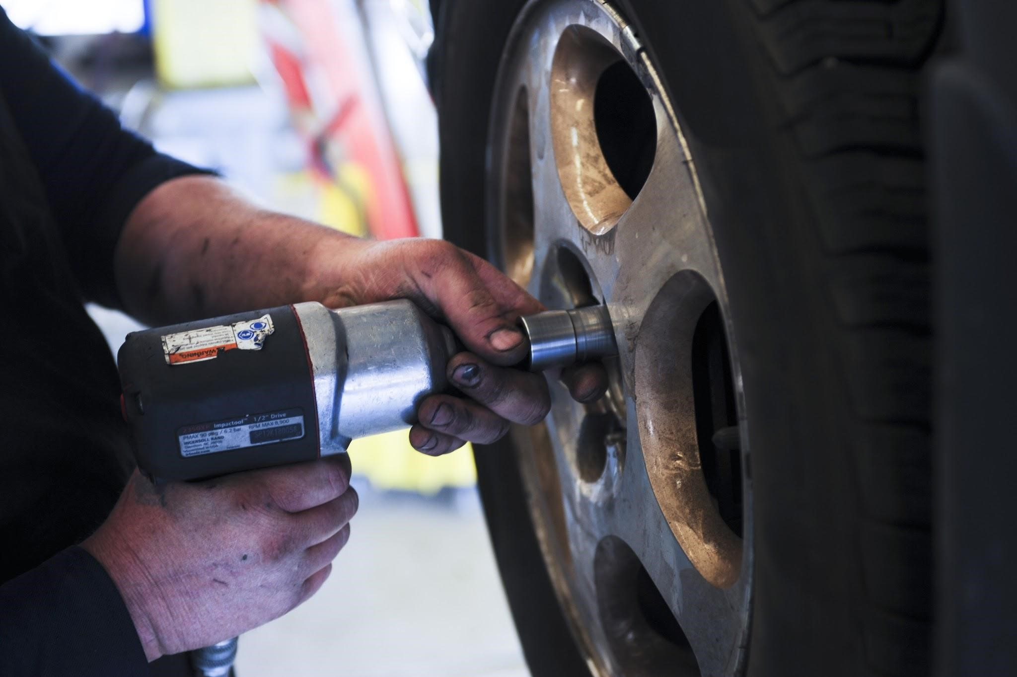 Are Car Repair Costs Driving You Into Debt? - changing car tyres image