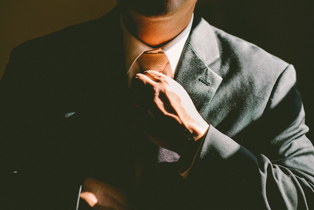 College Is The First Step To Fantastic Finances, What Comes Next? - man with suit and tie image