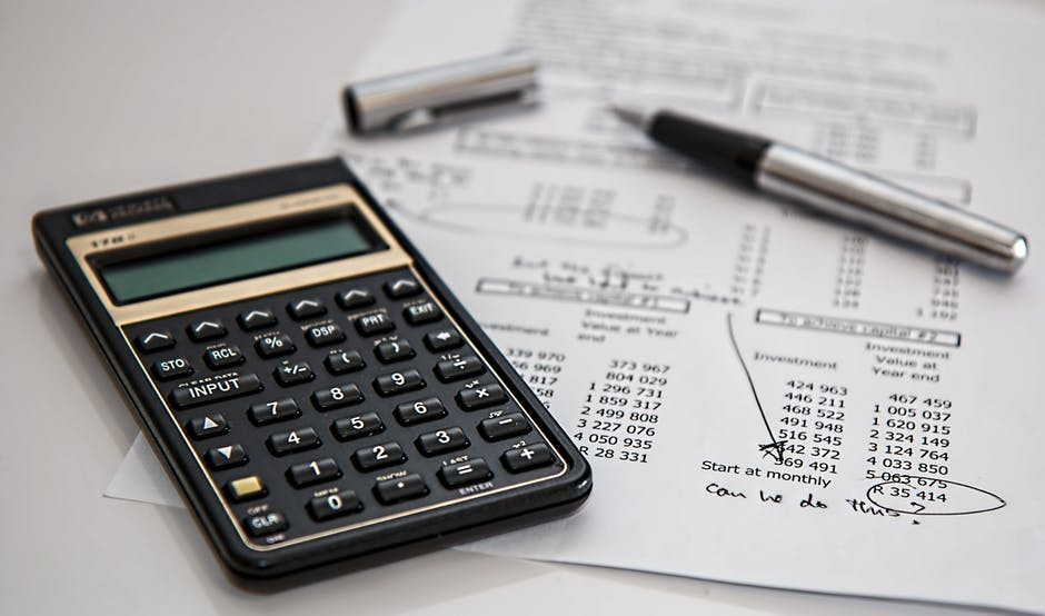 Managing Your Business' Money - black calculator and pen image