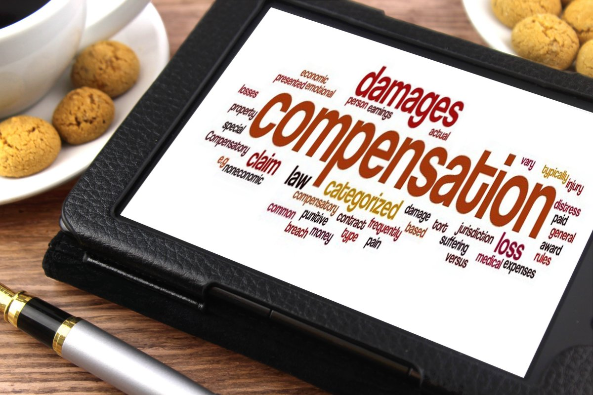 Myths About Making a Compensation Claim - tablet with compensation image