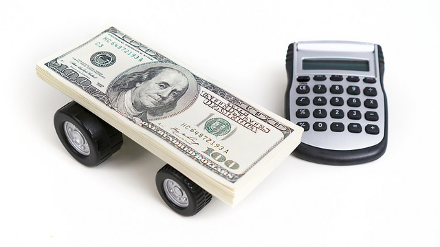 How To Lower Your Regular Transport Costs - car and calculator image