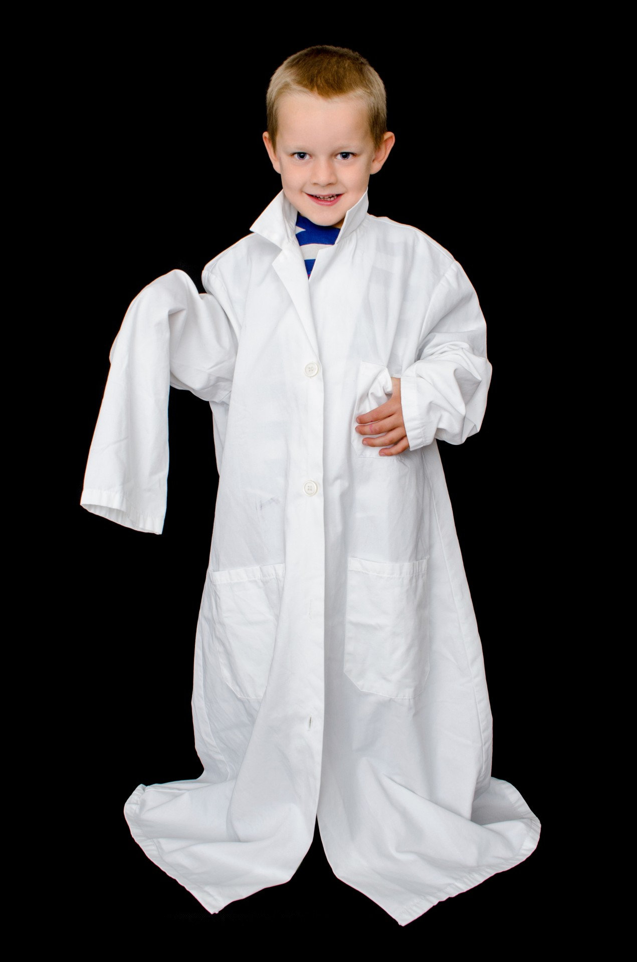 teaching your children about money - image of kid in oversize shirt