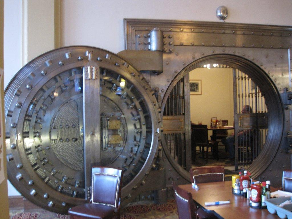 Unlock The Door To Financial Freedom - bank vault door image