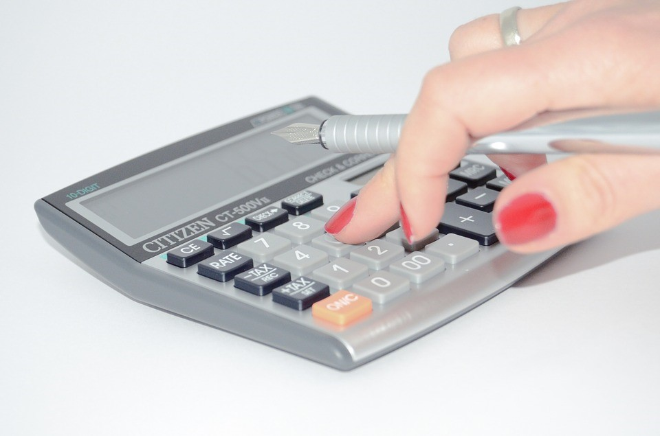 Achieve Regular Financial Savings By Incorporating These Simple Tricks Into Your Life - calculator image