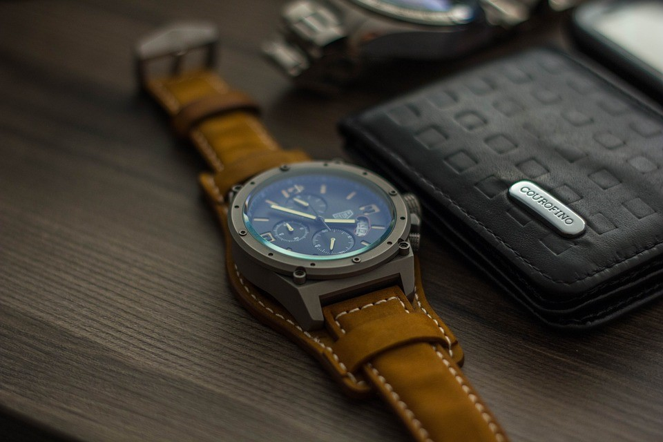 Filling Up Your Free Time, And Your Wallet In The Meantime - wallet and watch image