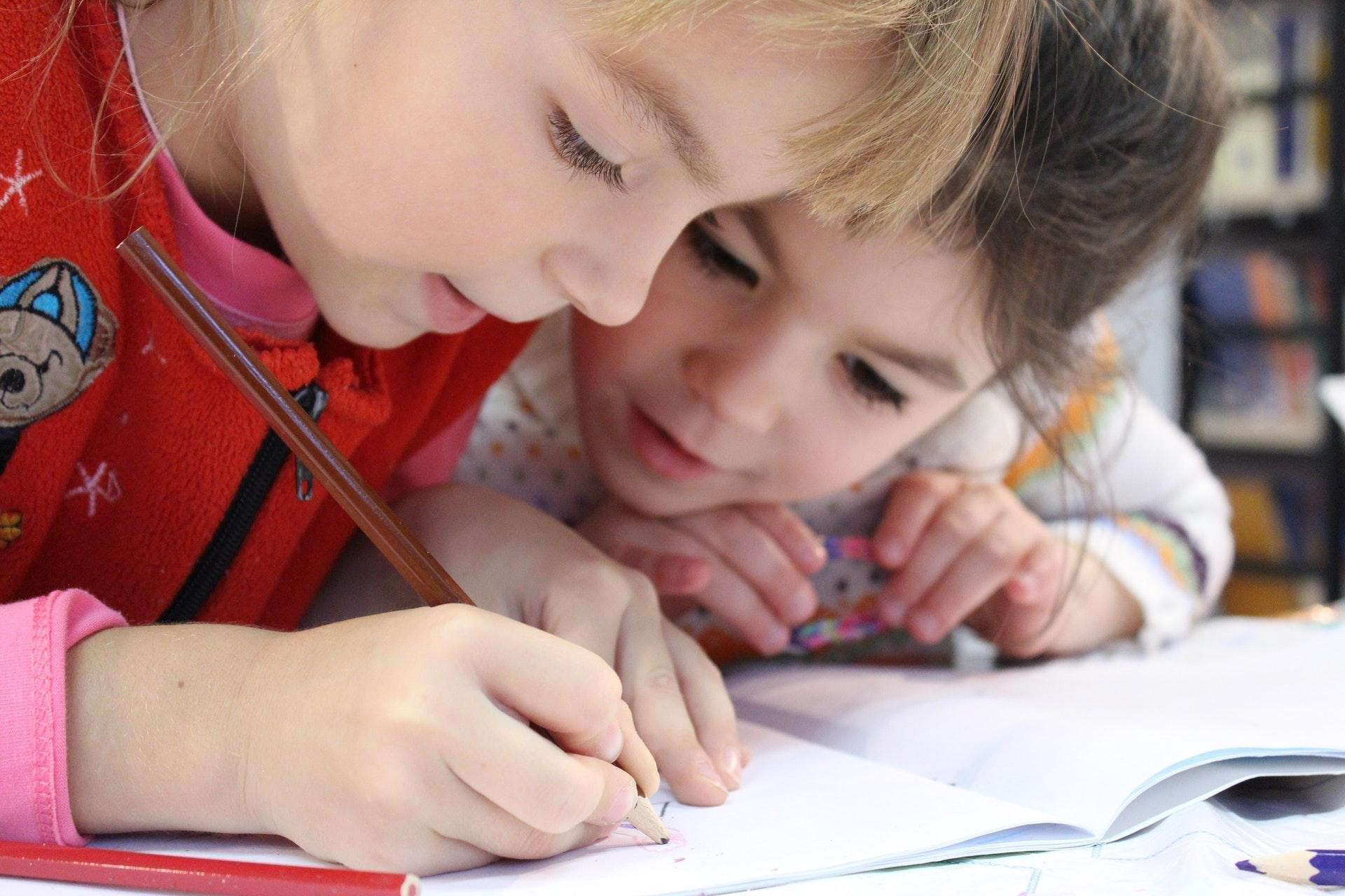 How to Teach Your Kids to Cut Household Expenses and Save Money - children writing image