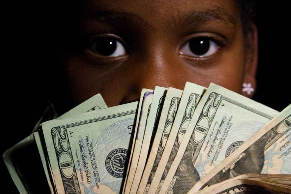 admin@wiserpet.com Teaching Your Children The Importance of Financial Self-Control - child with money image