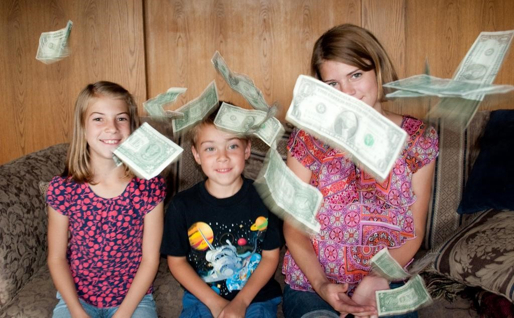 Are You Setting A Good Example For Your Kids In How You Handle Debt? - kids and money image