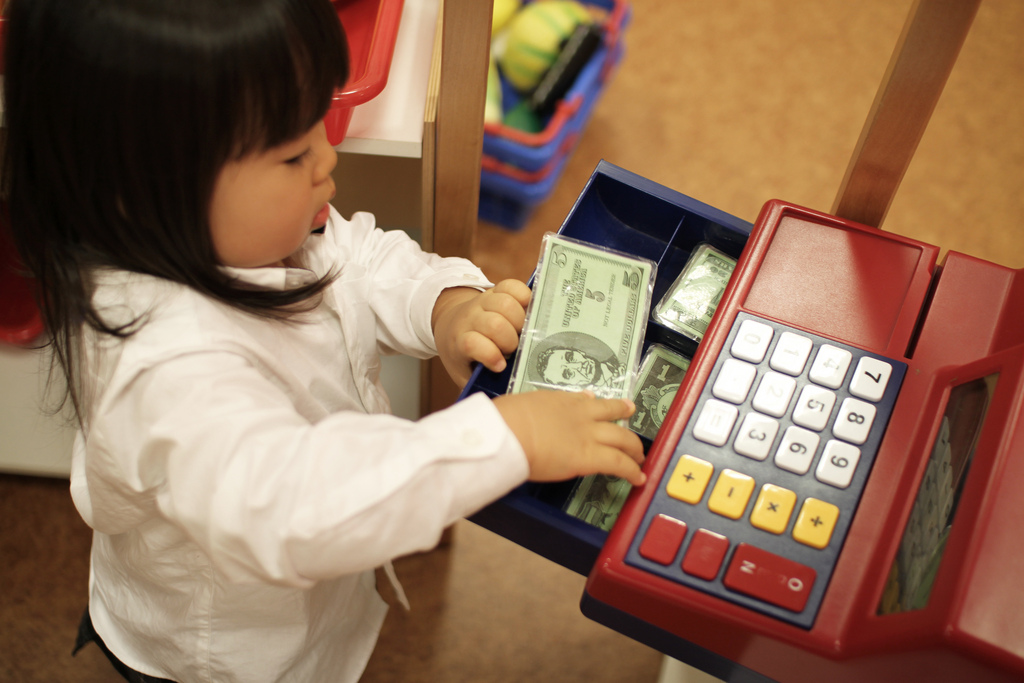 Teaching Kids The Money Game - play money image