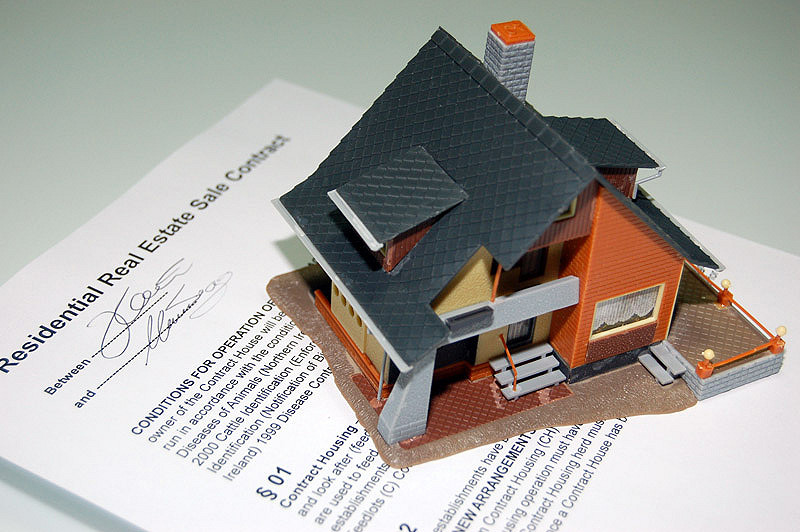 The Pros And Cons Of Borrowing Money - real estate contract image