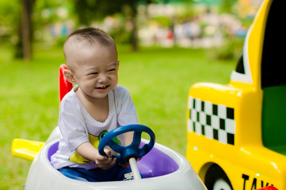 Spending Habits That Your Kids Must Never Pick Up - girl in toy car image