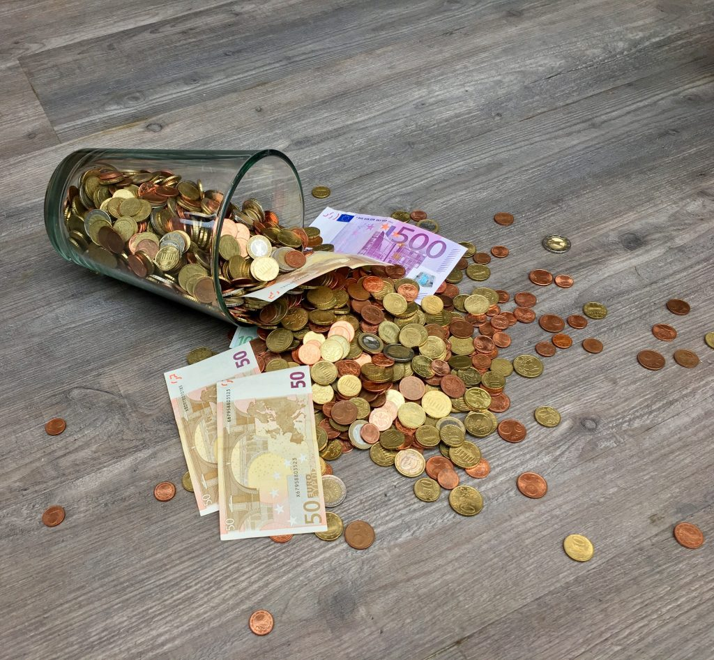 What Happens When You Get Stuck In A Financial Ditch - spilled coins and cash