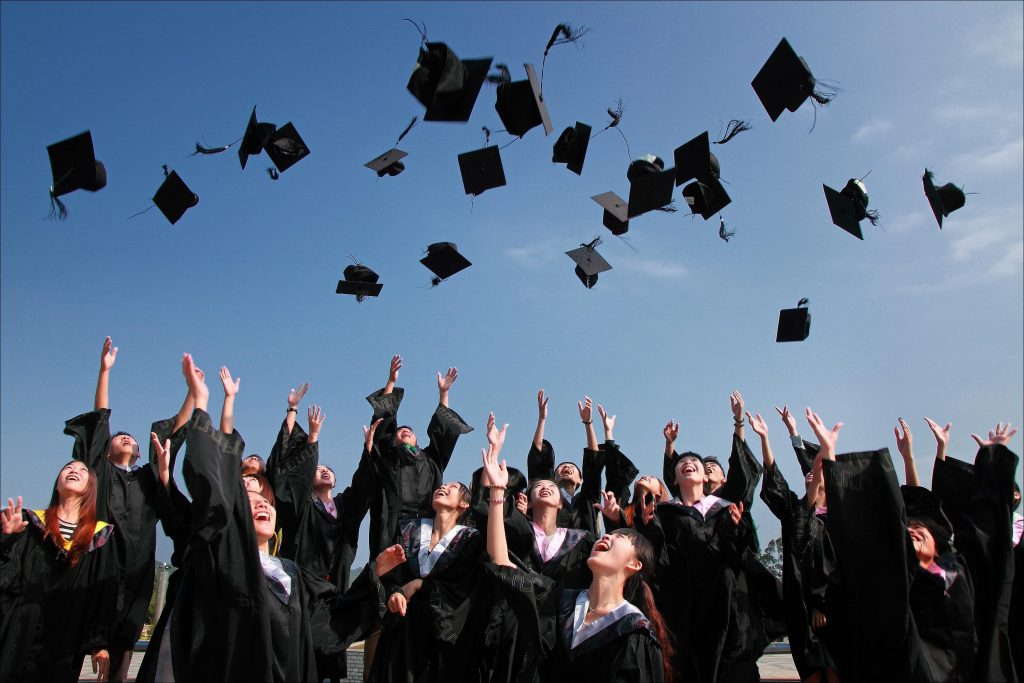 Discover Offers Employees Help With College Tuition - student graduation image