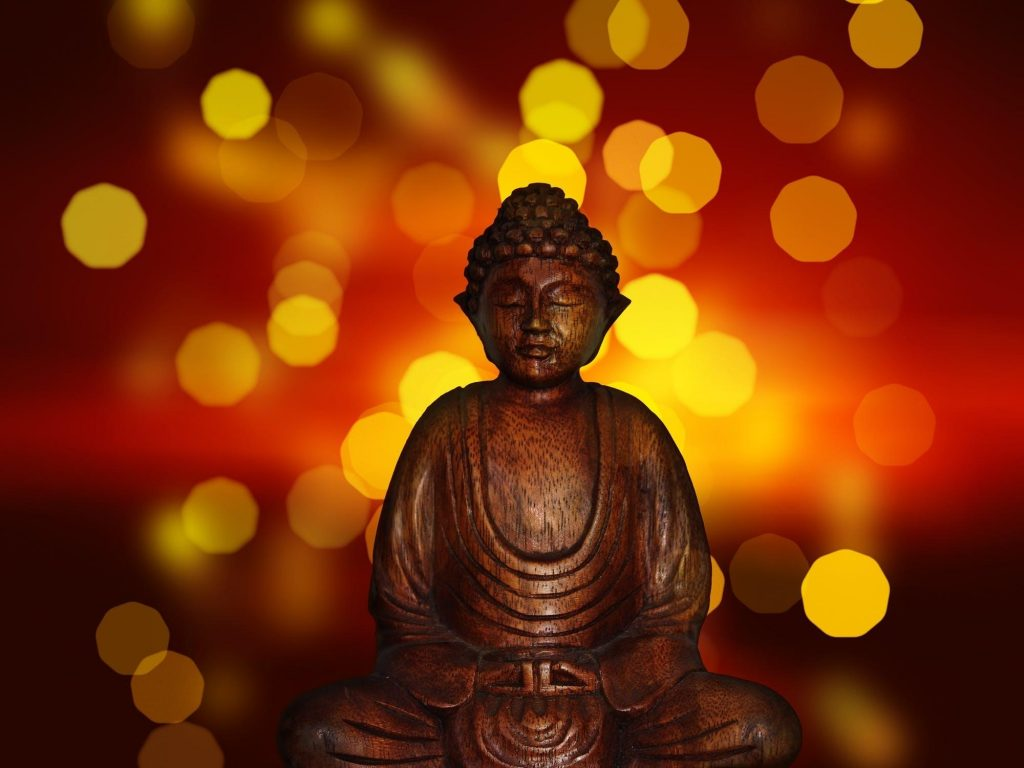 Decoding The Law Of Attraction According To Principles Of Mentalism - statue of praying Budha image